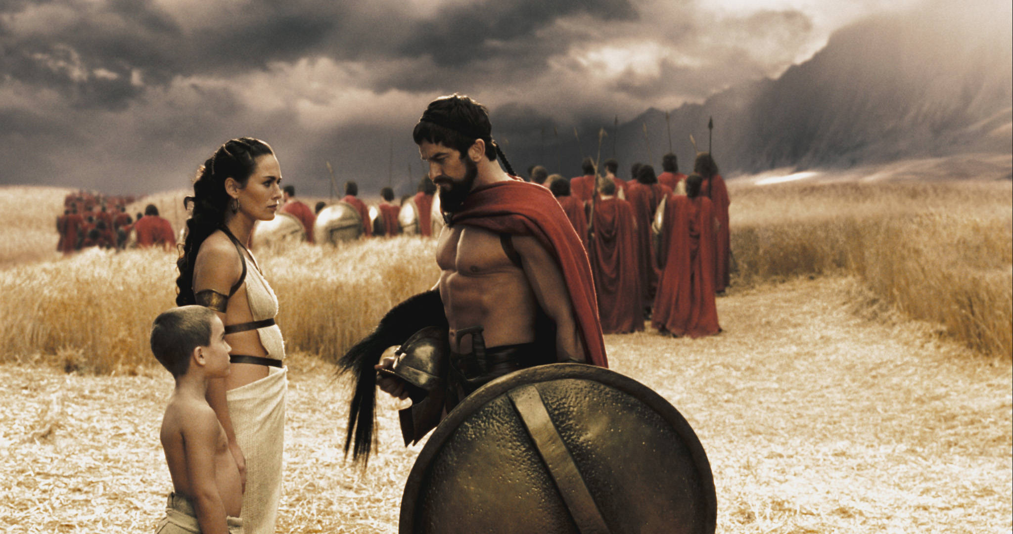 """Leonidas (GERARD BUTLER) bids farewell to his son Pleistarchos (GIOVANI ANTONIO CIMMINO) and wife Gorgo (LENA HEADEY) as the 300 begin their march north in Warner Bros. Pictures', Legendary Pictures' and Virtual Studios' action drama """"300,"""" distributed by Warner Bros. Pictures. PHOTOGRAPHS TO BE USED SOLELY FOR ADVERTISING, PROMOTION, PUBLICITY OR REVIEWS OF THIS SPECIFIC MOTION PICTURE AND TO REMAIN THE PROPERTY OF THE STUDIO. NOT FOR SALE OR REDISTRIBUTION"""